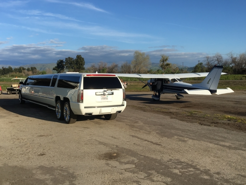 Prestige Limousine Cadillac limo - next to small airplane