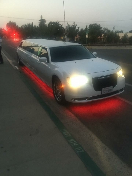 Prestige Limousine Chrysler limo - red ground lighting