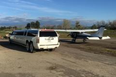 Prestige Limousine Cadillac limo - next to small airplane